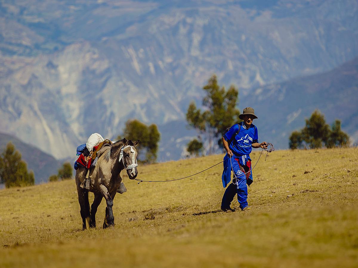Porter with the horse on Salkantay Trek to Machu Picchu in Peru