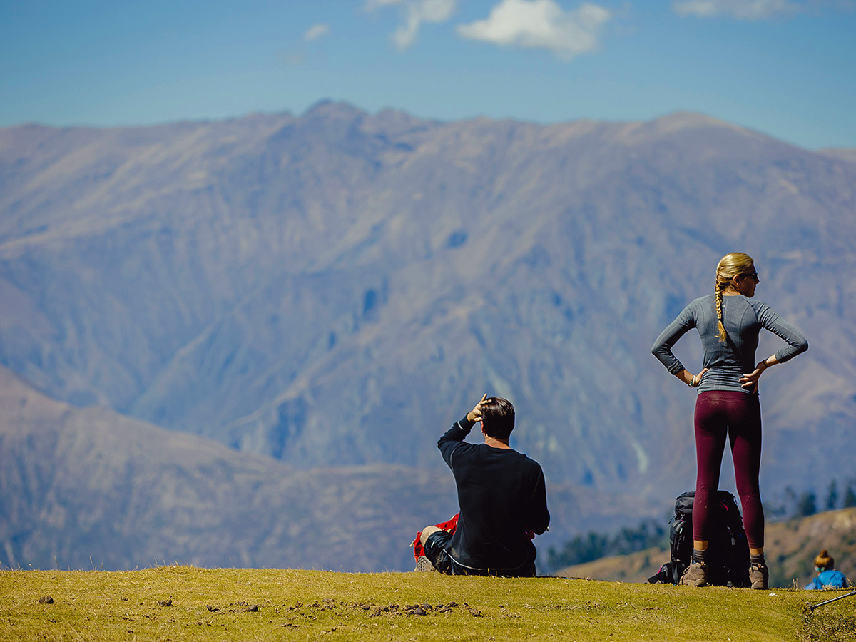 Hikers enjoying the views on Salkantay Trek to Machu Picchu in Peru