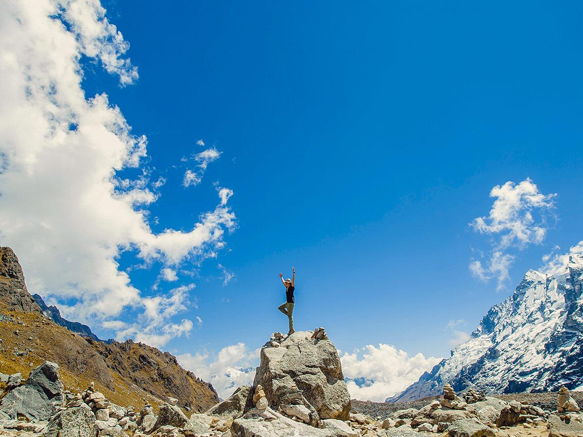 Streching on the big rock on Salkantay Trek to Machu Picchu in Peru