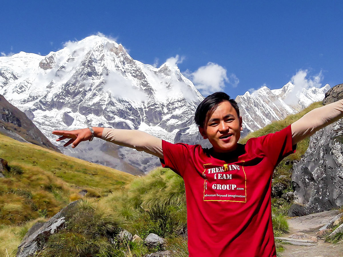 Guide posing in front of the massif on Annapurna Base Camp Guided Trek in Nepal