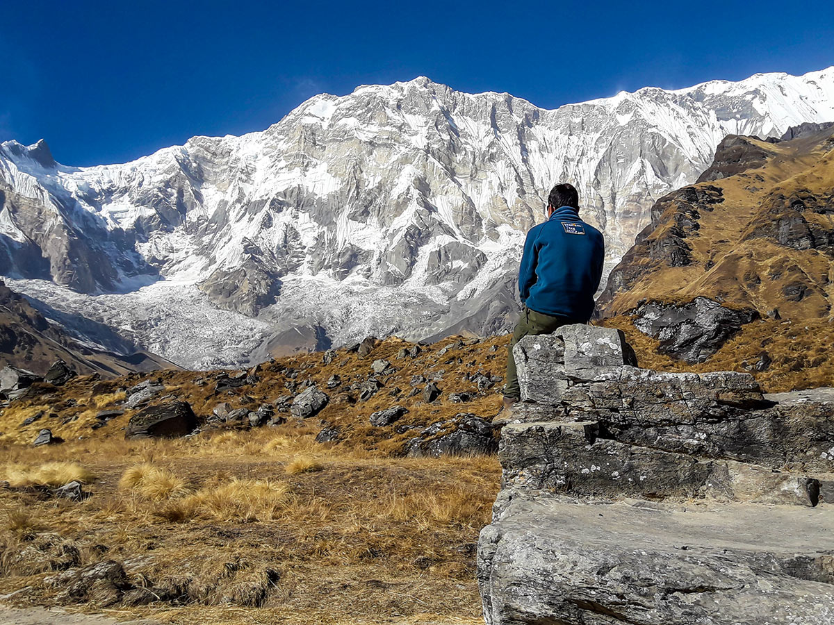 Porter on Annapurna Base Camp Guided Trek in Nepal observing beautiful Himalayan views