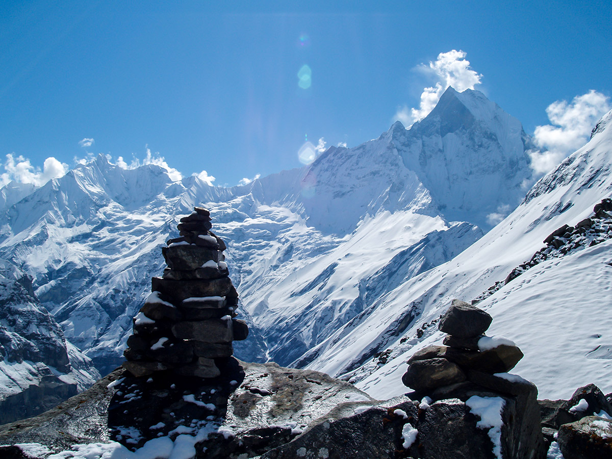 Cairn in front of mountain peaks on Annapurna Base Camp Guided Trek in Nepal