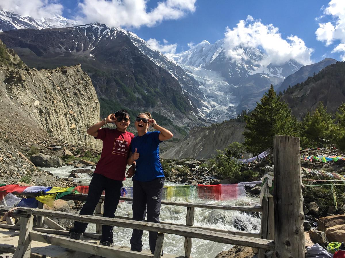 Hikers posing near Annapurna Massif on guided Annapurna Circuit hike in Nepal