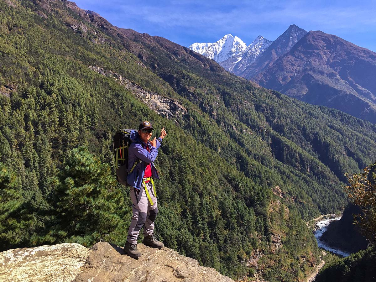 Hiker pointing to mountains on Annapurna and Everest Luxury Lodge Trek