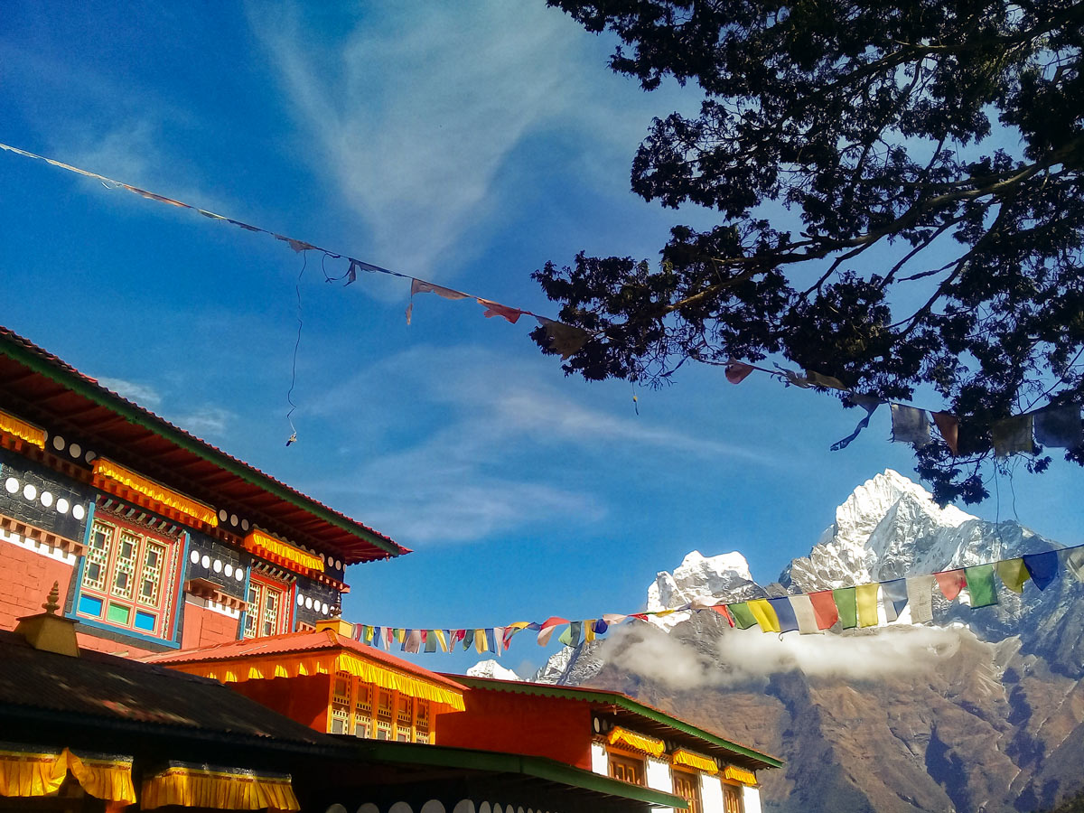 Prayer flag lodge and mountain views on Everest Base Camp trek in Nepal