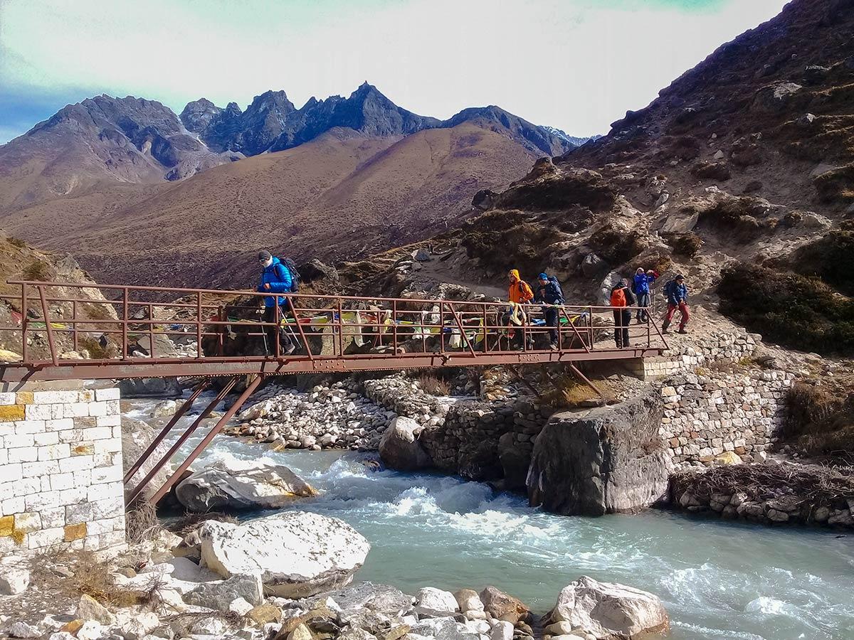 Trekkers crossing the bridge on Everest Base Camp trek in Nepal