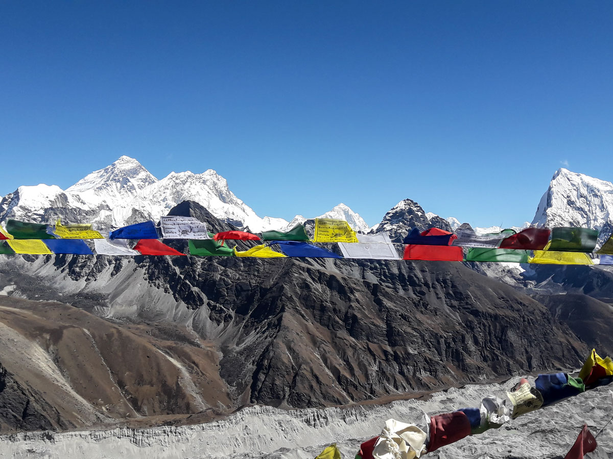 Prayer flag and Himalayan Mountains on Everest Base Camp and Gokyo Lake trek in Nepal