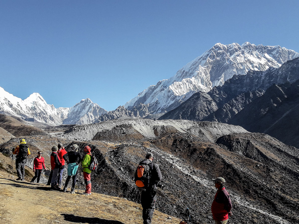 Group of hikers observing views on Everest Base Camp and Gokyo Lake trek in Nepal