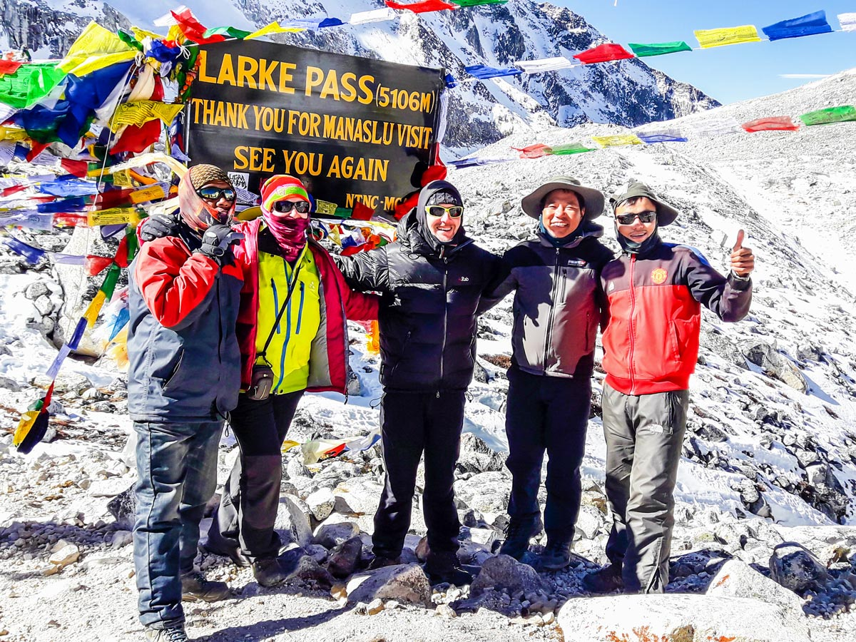 Hikers posing near Larke Pass on Manaslu Circuit trek in Nepal