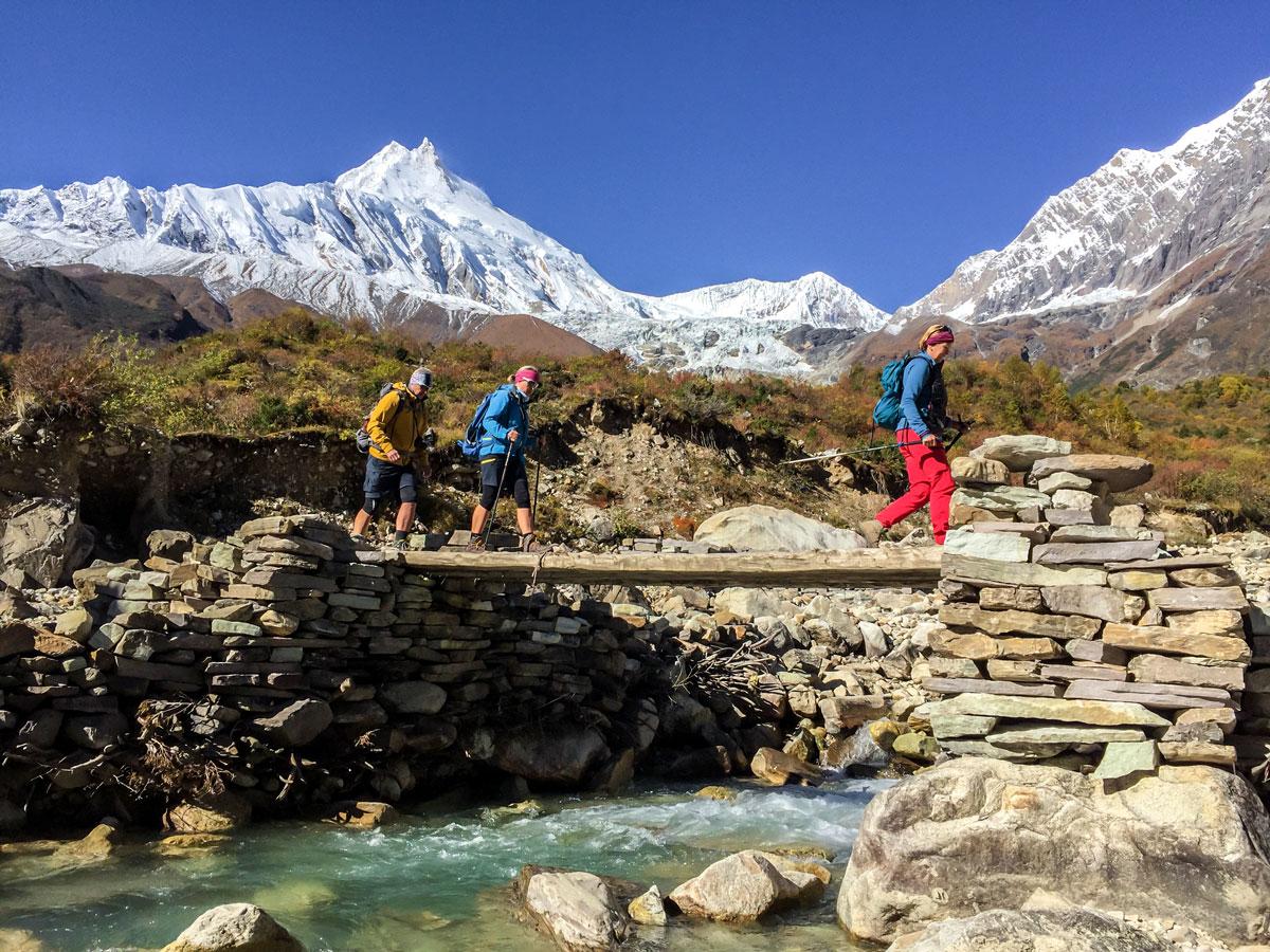 Crossing the river on Manaslu Circuit trek in Nepal