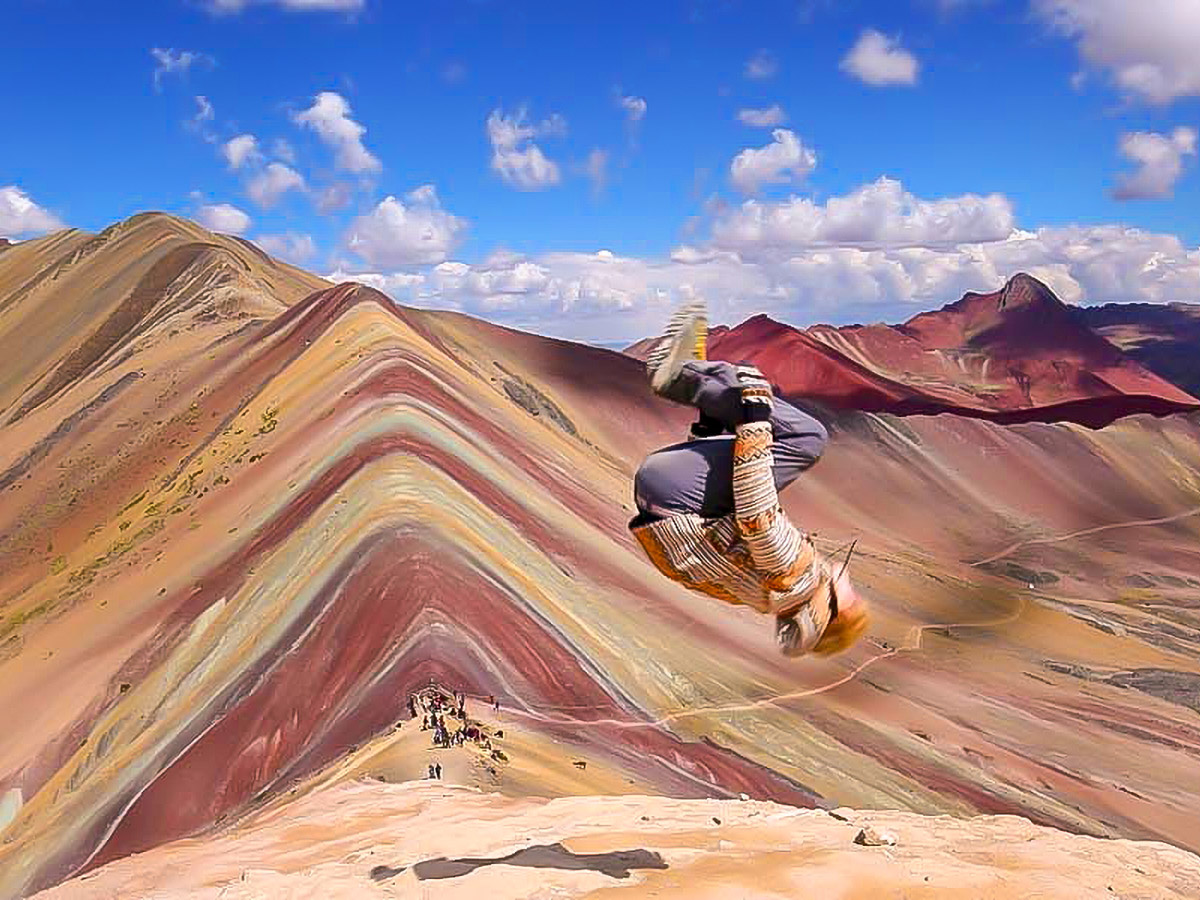 A person doing a flip on the Rainbow Mountains of Peru