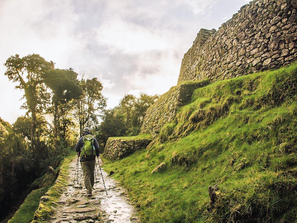 Hiker on Inca Trail to Machu Picchu near Cusco Peru