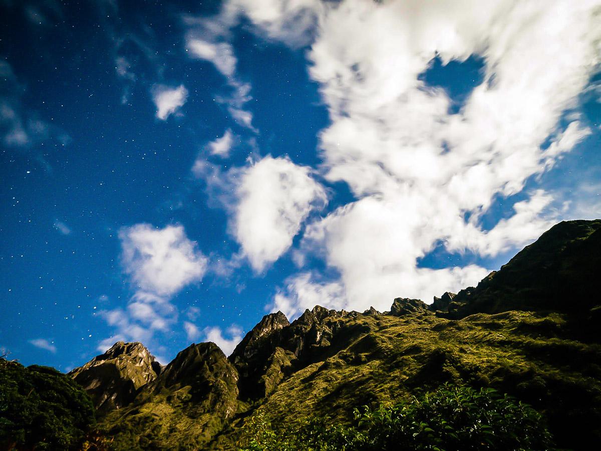 Rocky peaks and cloudy sky on Inca Trail to Machu Picchu near Cusco Peru