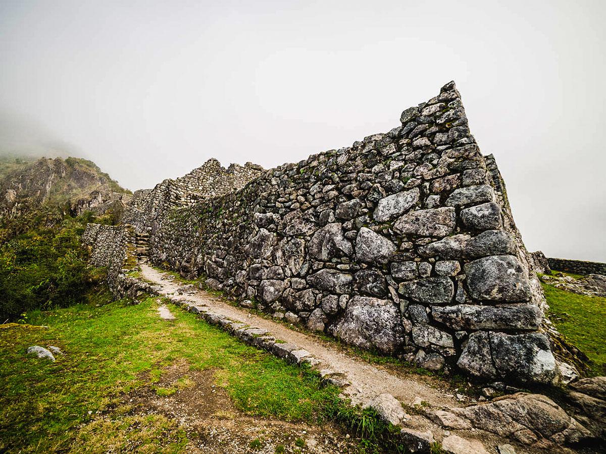 One of several Incan ruins youll see along Inca Trail to Machu Picchu near Cusco Peru