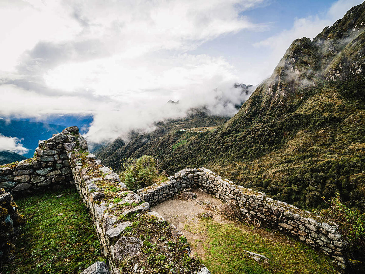 Looking down on the valley from Incan ruins on Inca Trail to Machu Picchu near Cusco Peru