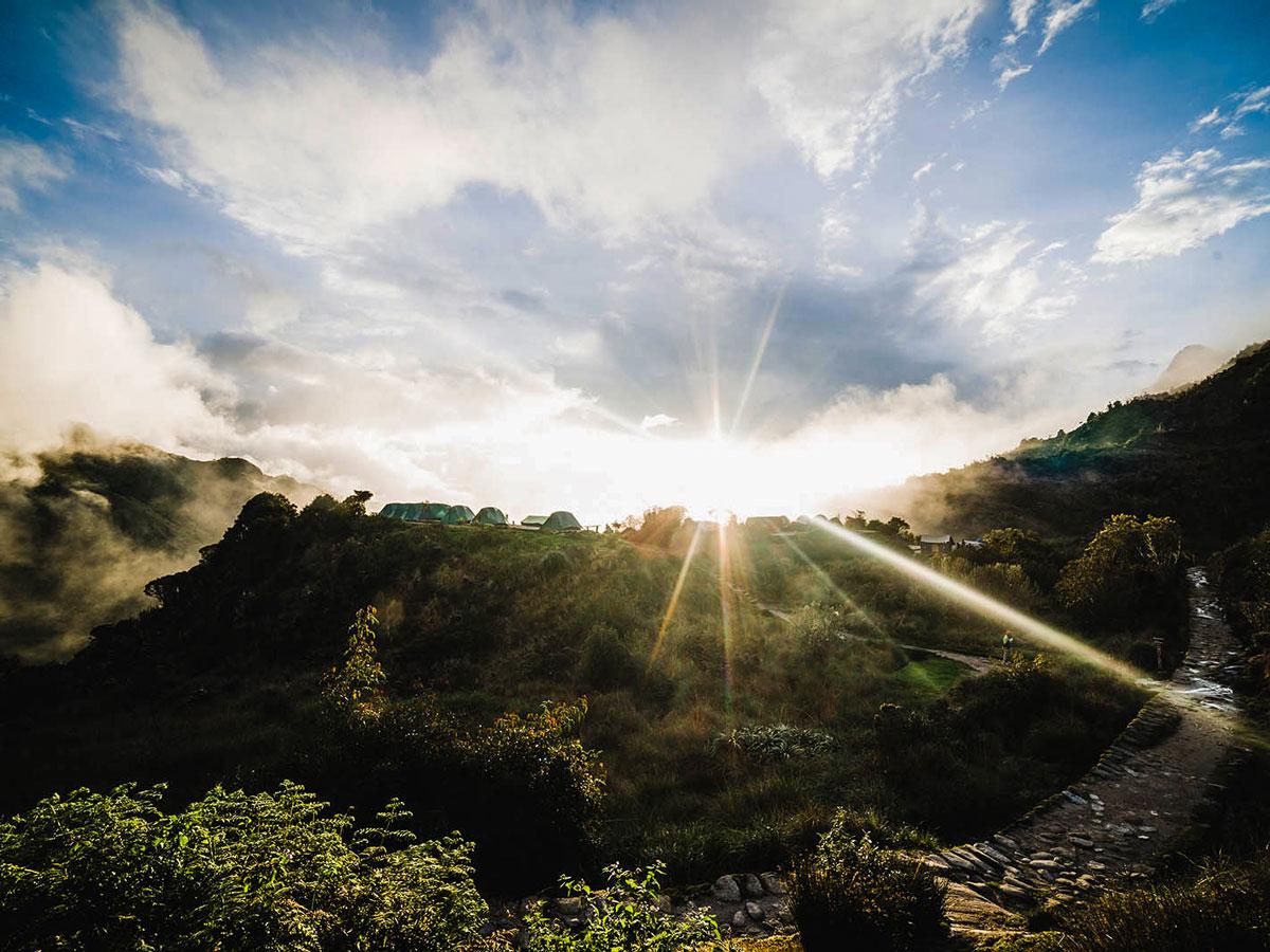 Sun shining on the trail of Inca Trail to Machu Picchu near Cusco Peru