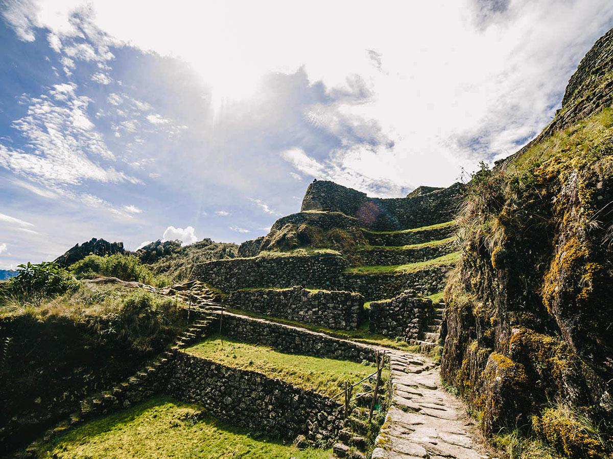 Exploring Incan ruins on Inca Trail to Machu Picchu near Cusco Peru