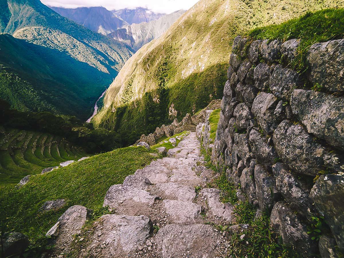 Exploring Winay Wayna ruins on Inca Trail to Machu Picchu near Cusco Peru