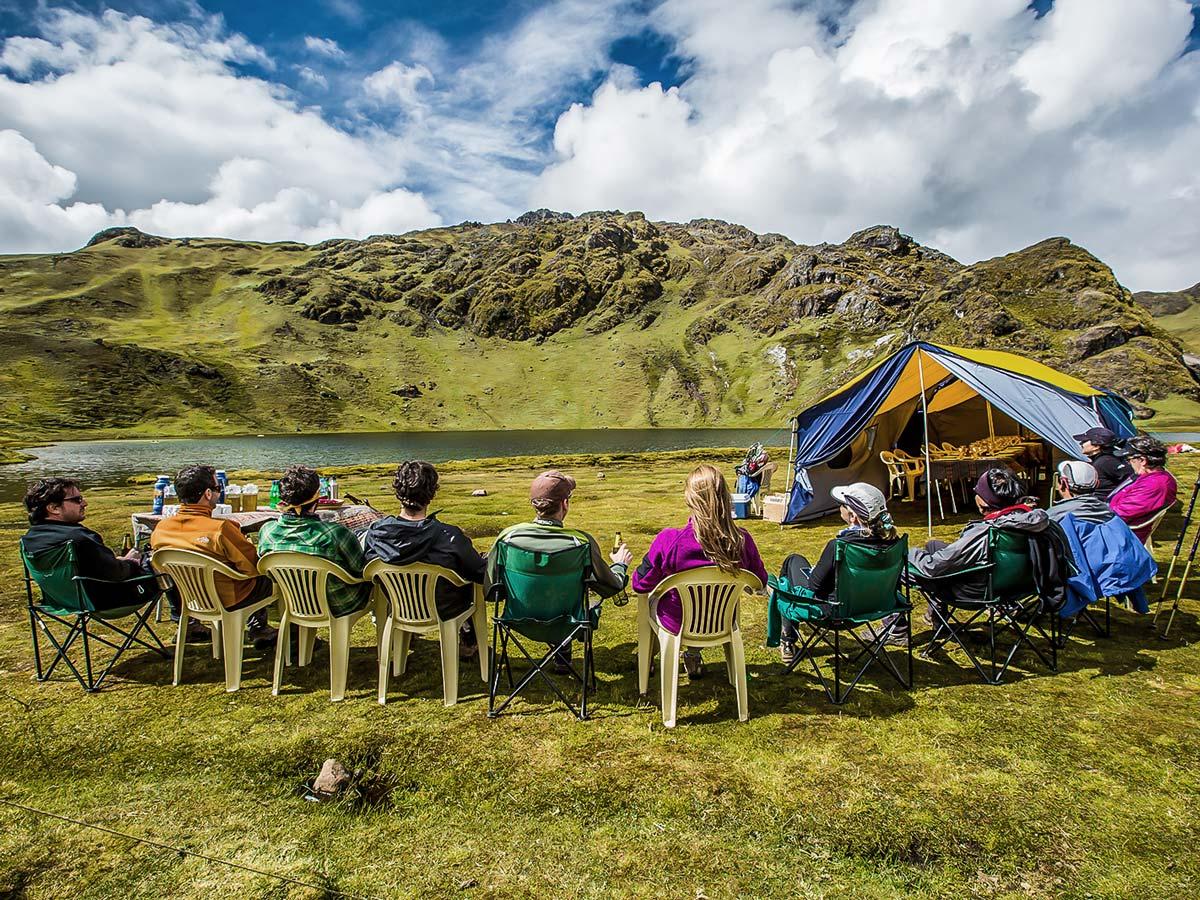 Resting with group on Lares Trek to Machu Picchu near Cusco Peru
