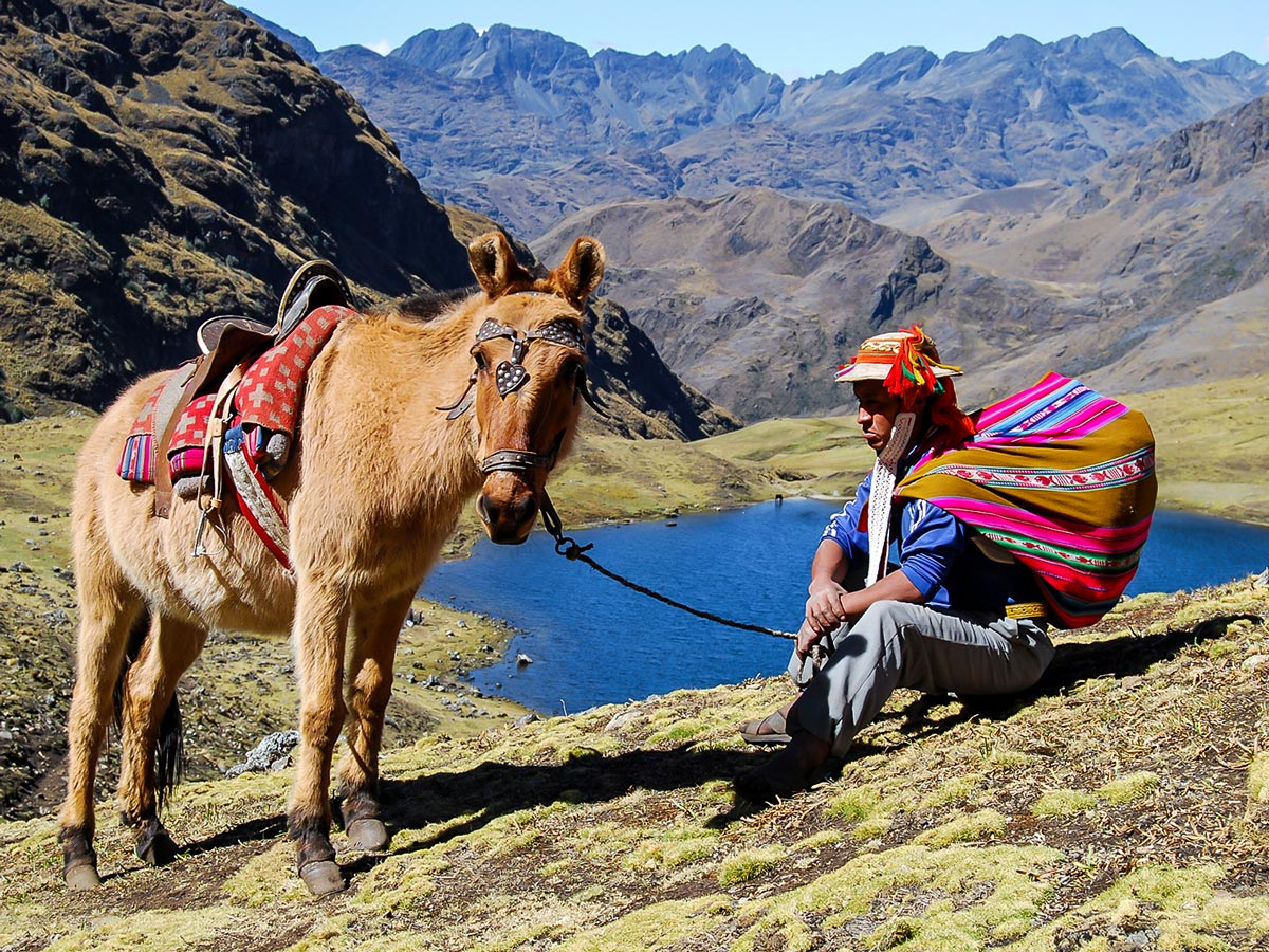 Horse local person and beautiful scenery behind on Lares Trek to Machu Picchu near Cusco Peru