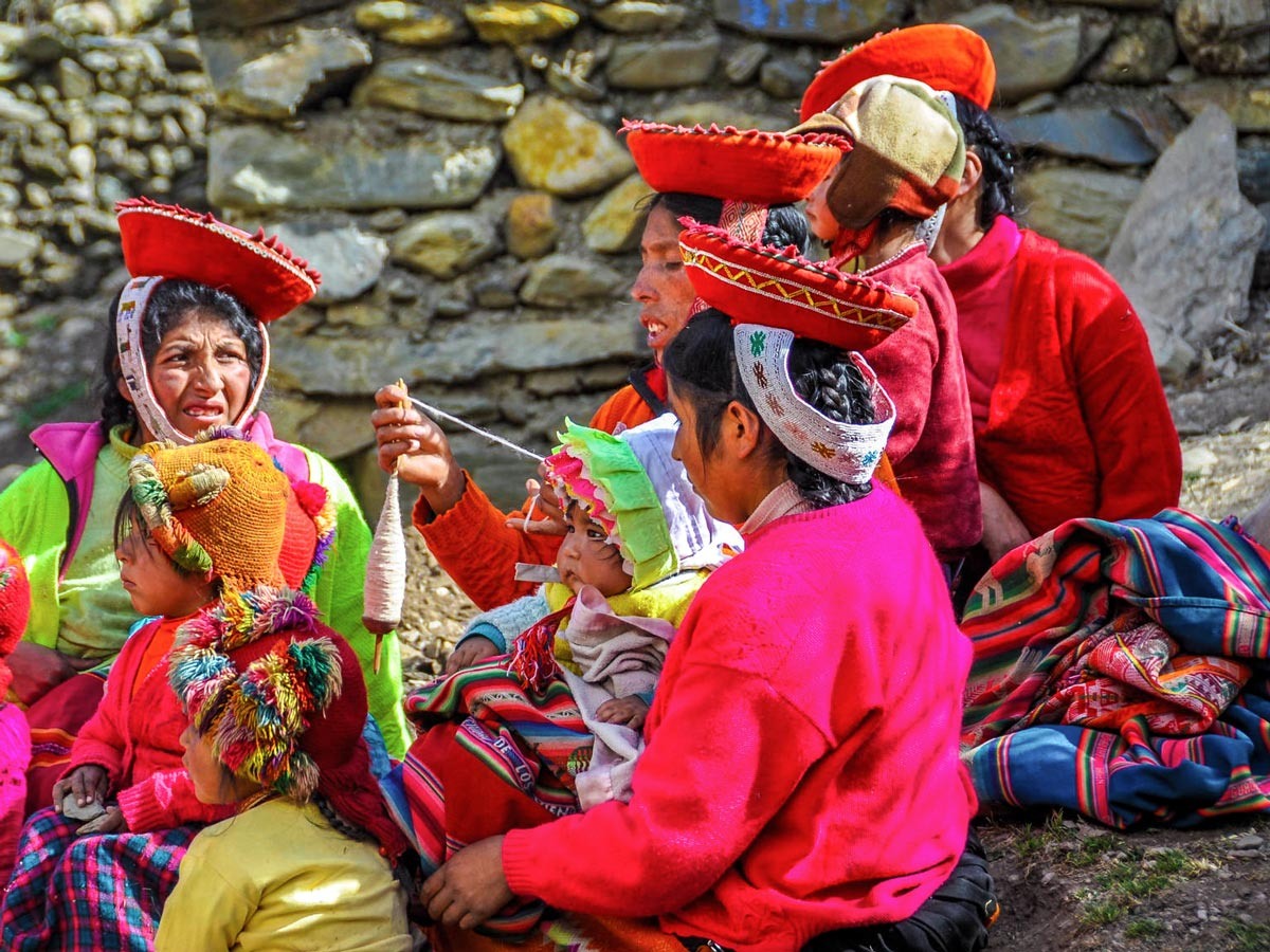 Quechua women dressed in colorful clothing on Lares Trek to Machu Picchu near Cusco Peru