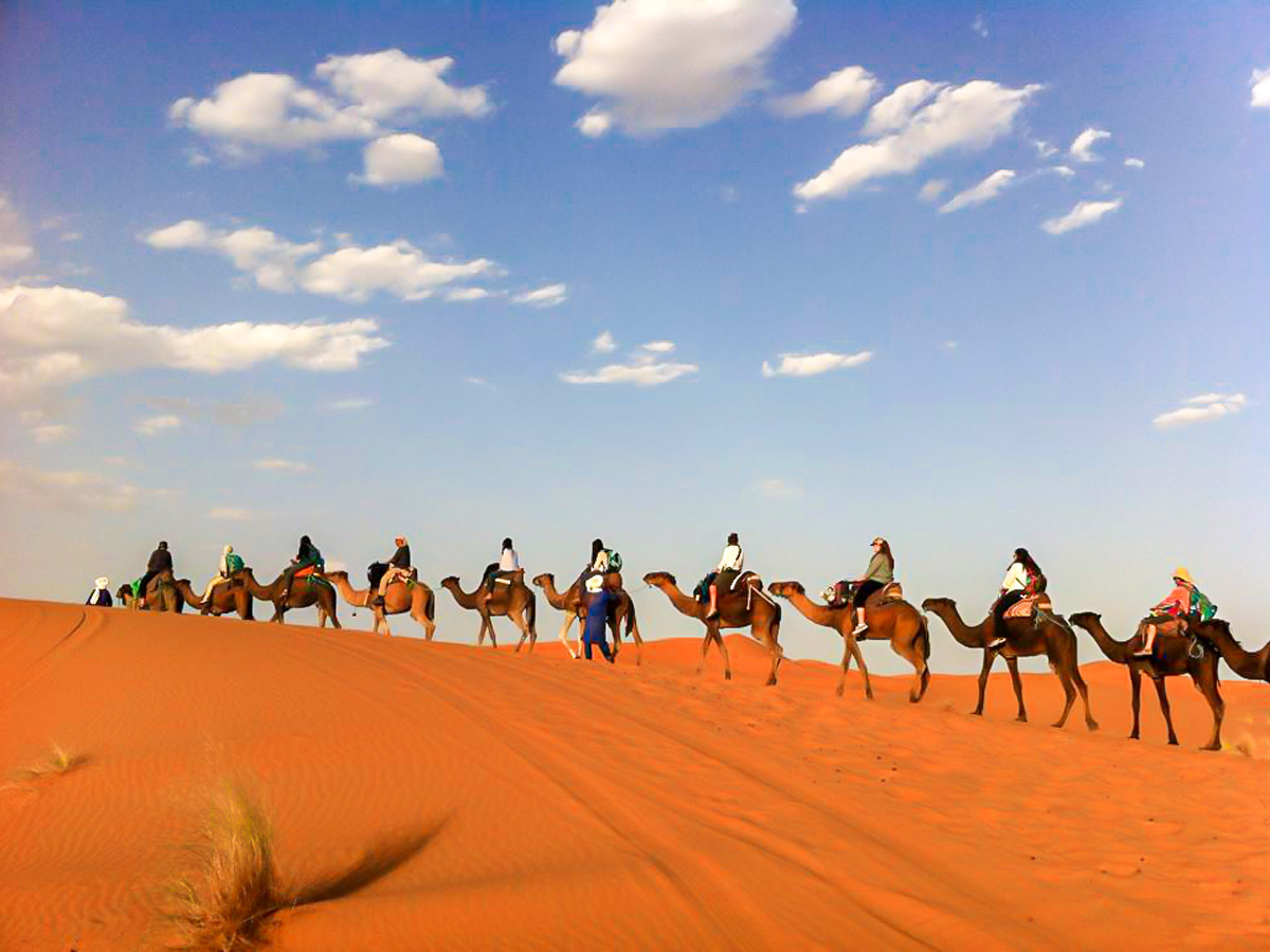 Camel riding is an exciting part of Atlas and Sahara Trek in Morocco