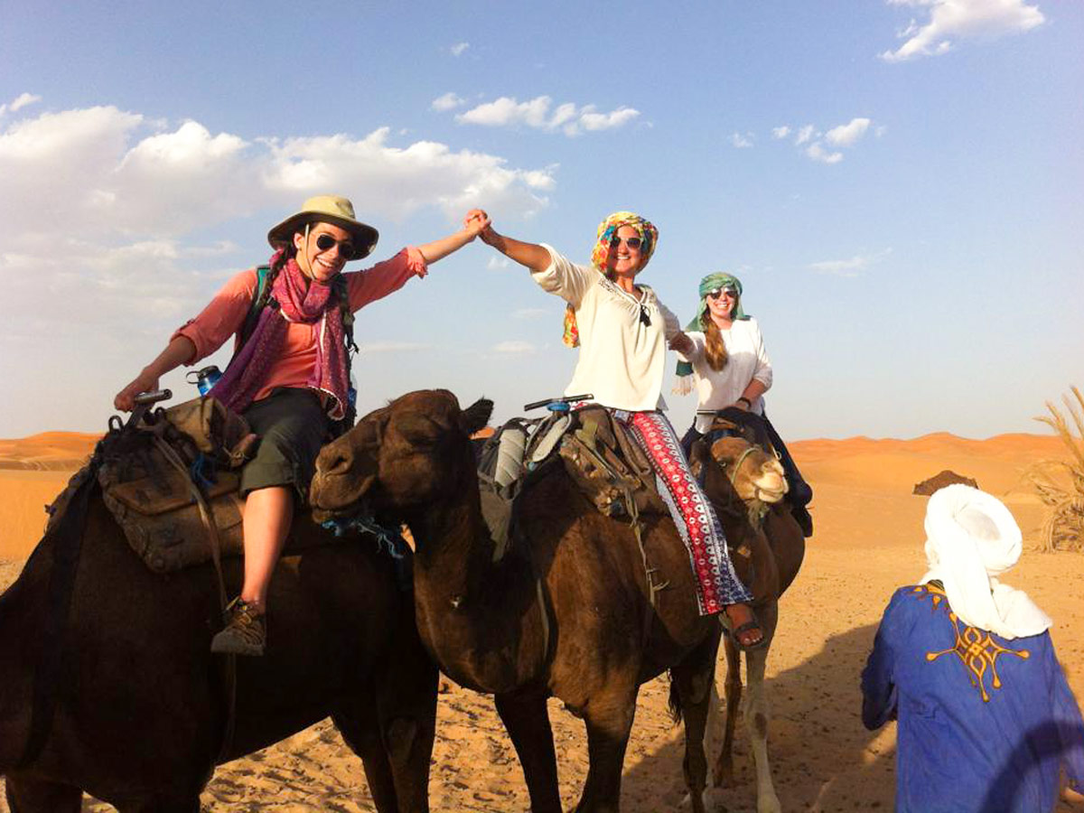 Riding a camel in Sahara is a must do activity in Morocco
