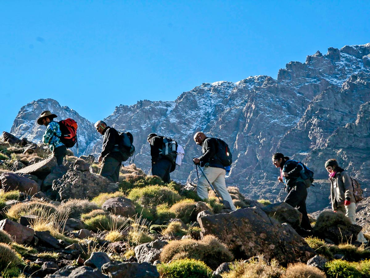 Group of hikers ascending on Mt Toubkal and Desert tour in Morocco