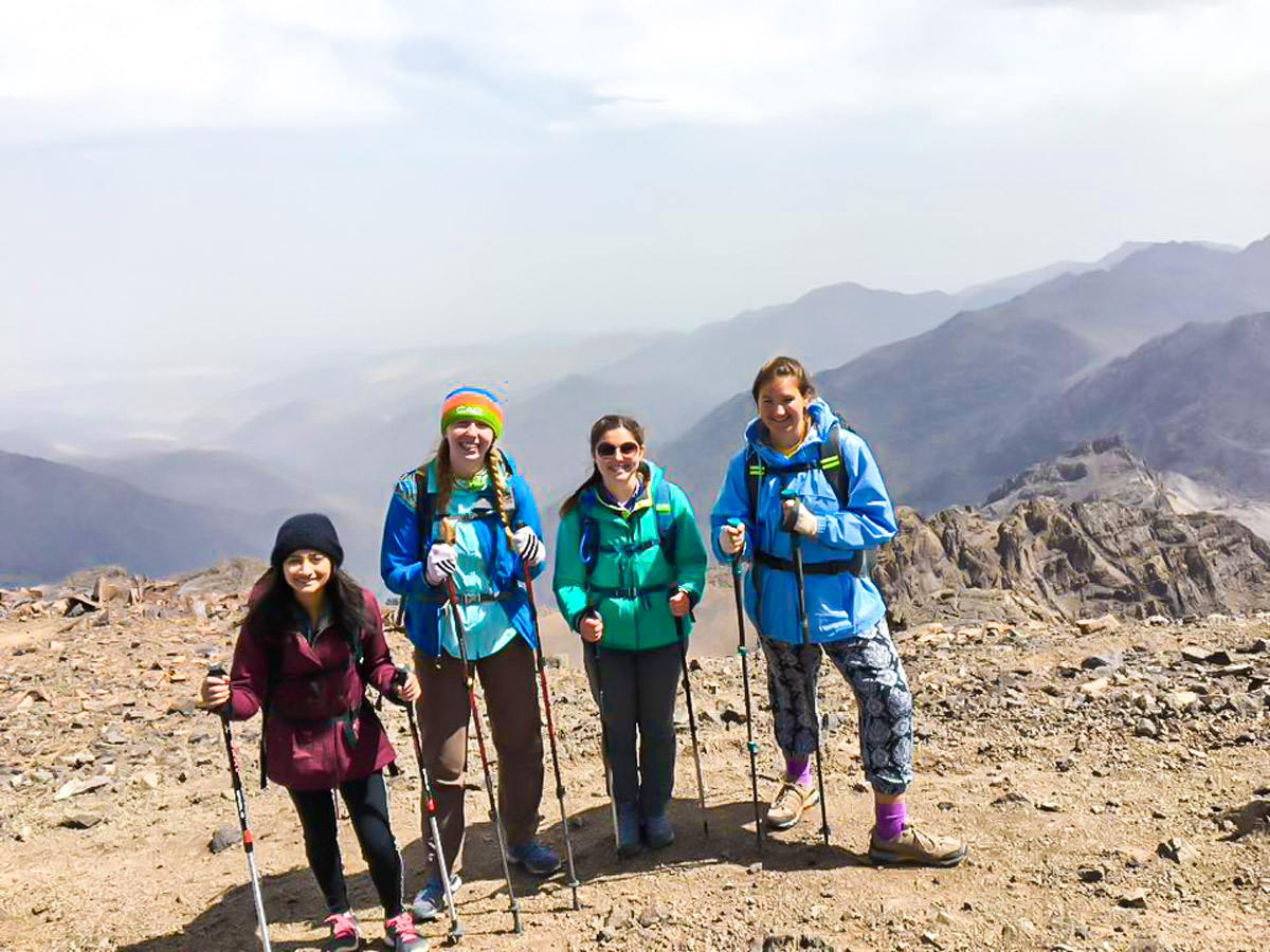 4 female hikers posing on Villages Valleys and Mt Toubkal Climb tour in Morocco