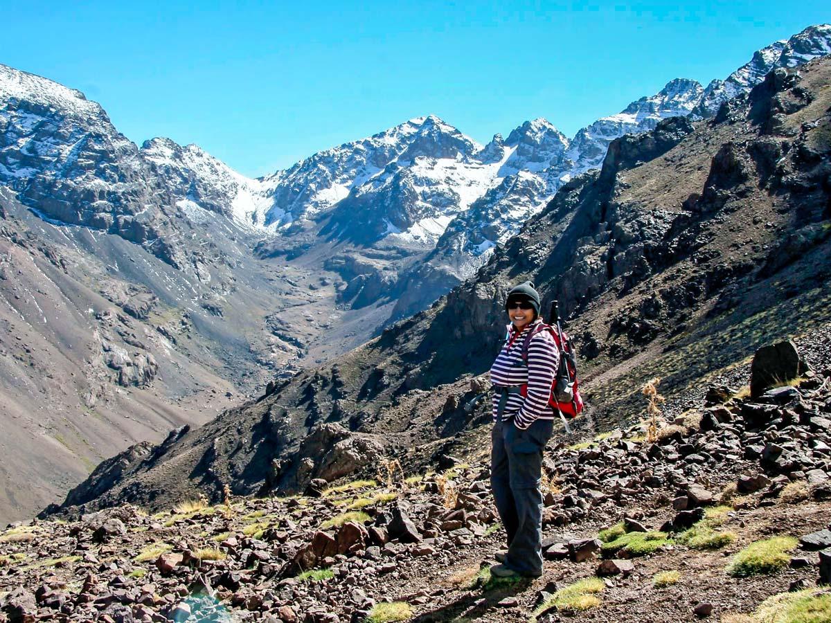 Posing in front of snowy peaks on Mt Toubkal Trek in Atlas Mountains Morocco