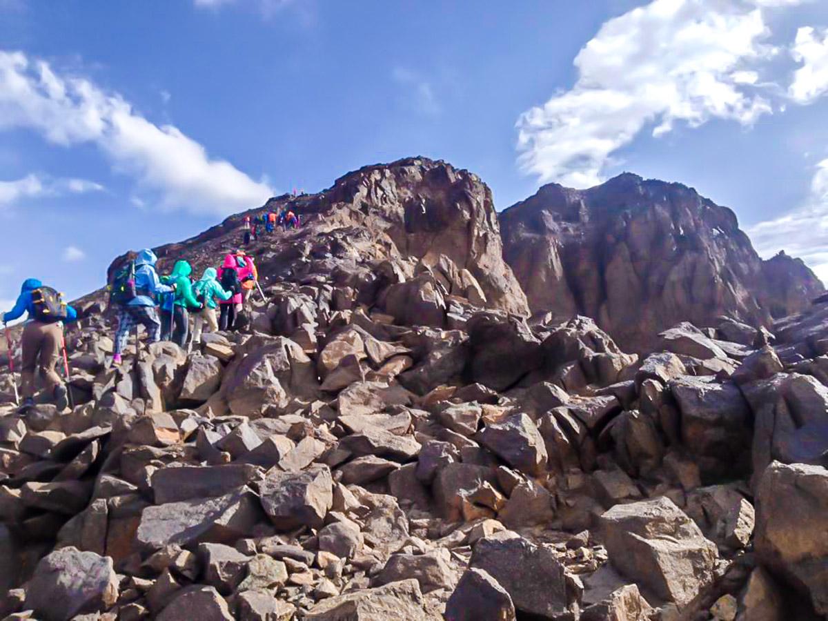 Climbing to the peak on Mt Toubkal Trek in Atlas Mountains Morocco