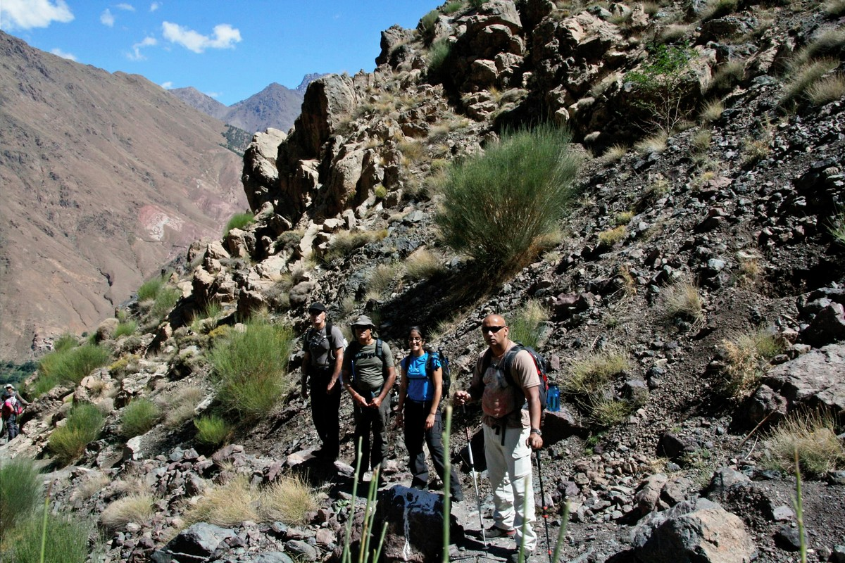 Group of hikers on a trail of guided trekking tour to Atlas Valley from Marrakech Morocco