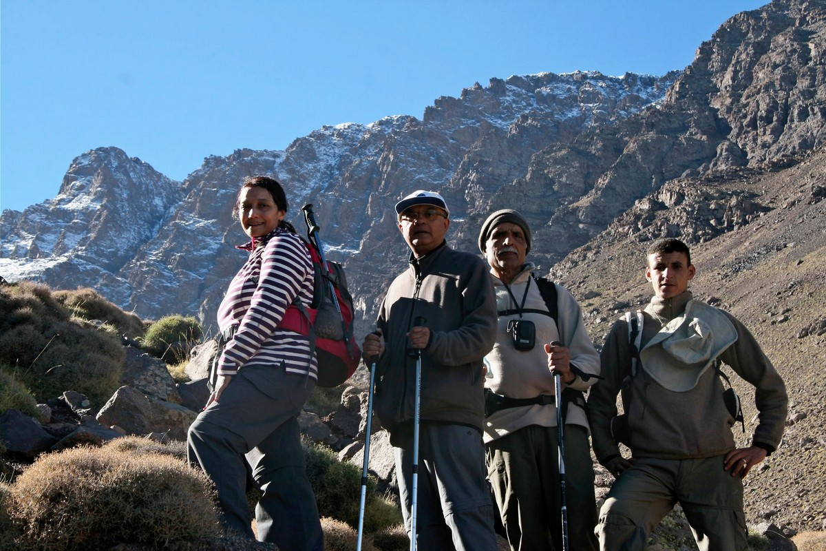 Posing in front of snowy peaks on guided tour to Atlas Mountains