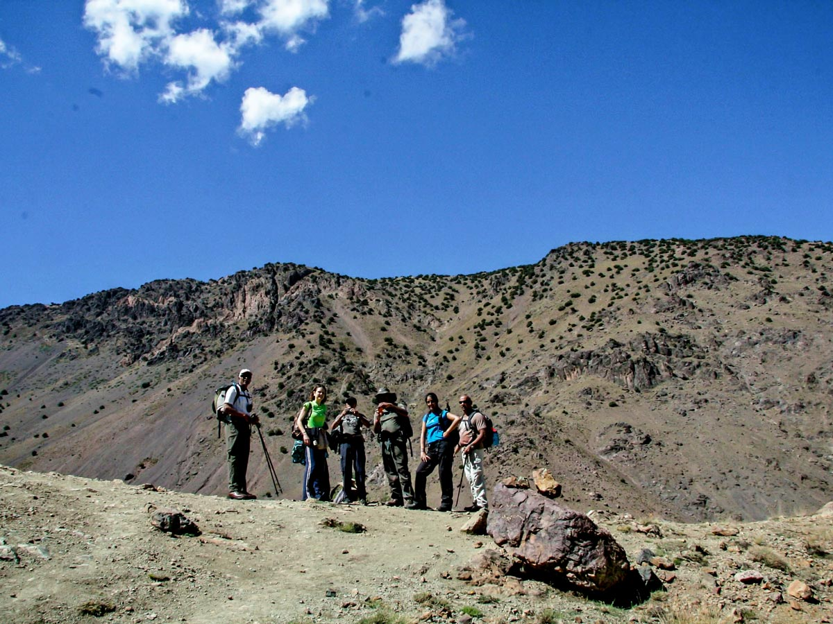 Group of trekkers on Mt Toubkal Circuit Trek in Morocco in front of the mountains