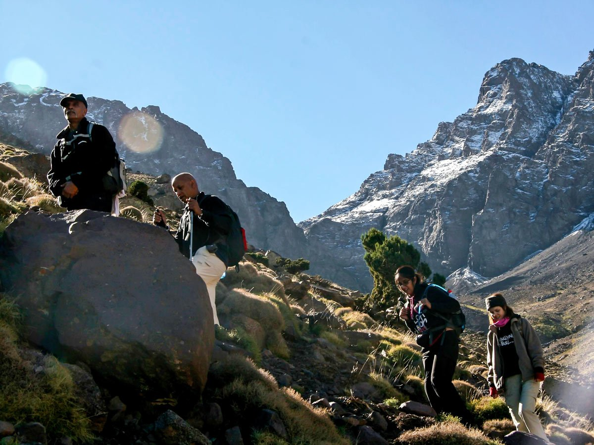 Group of hikers ascending on Mt Toubkal Circuit Trek in Morocco