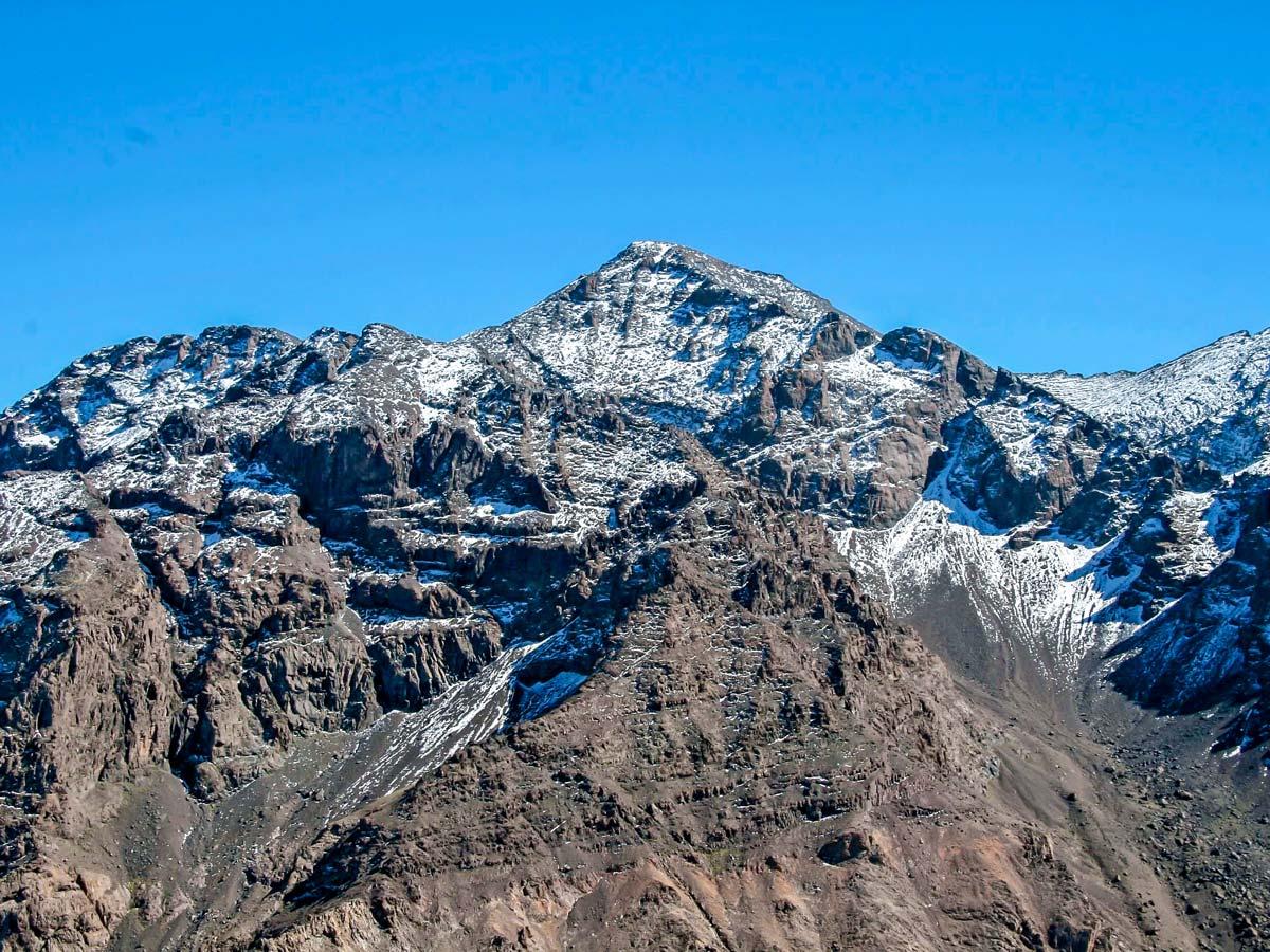 Snowy peaks surrounding the trail of Mt Toubkal Circuit Trek in Morocco