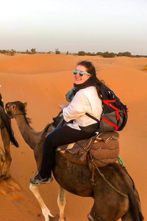 Trekker enjoying the camel ride on Merzouga Overland Tour in Morocco