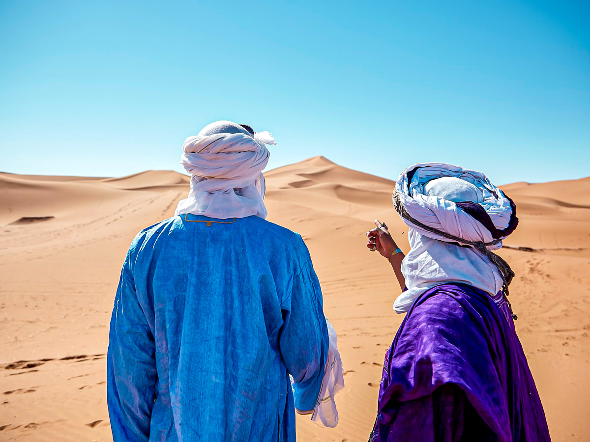 Guide and hiker on Merzouga Overland Tour in Morocco