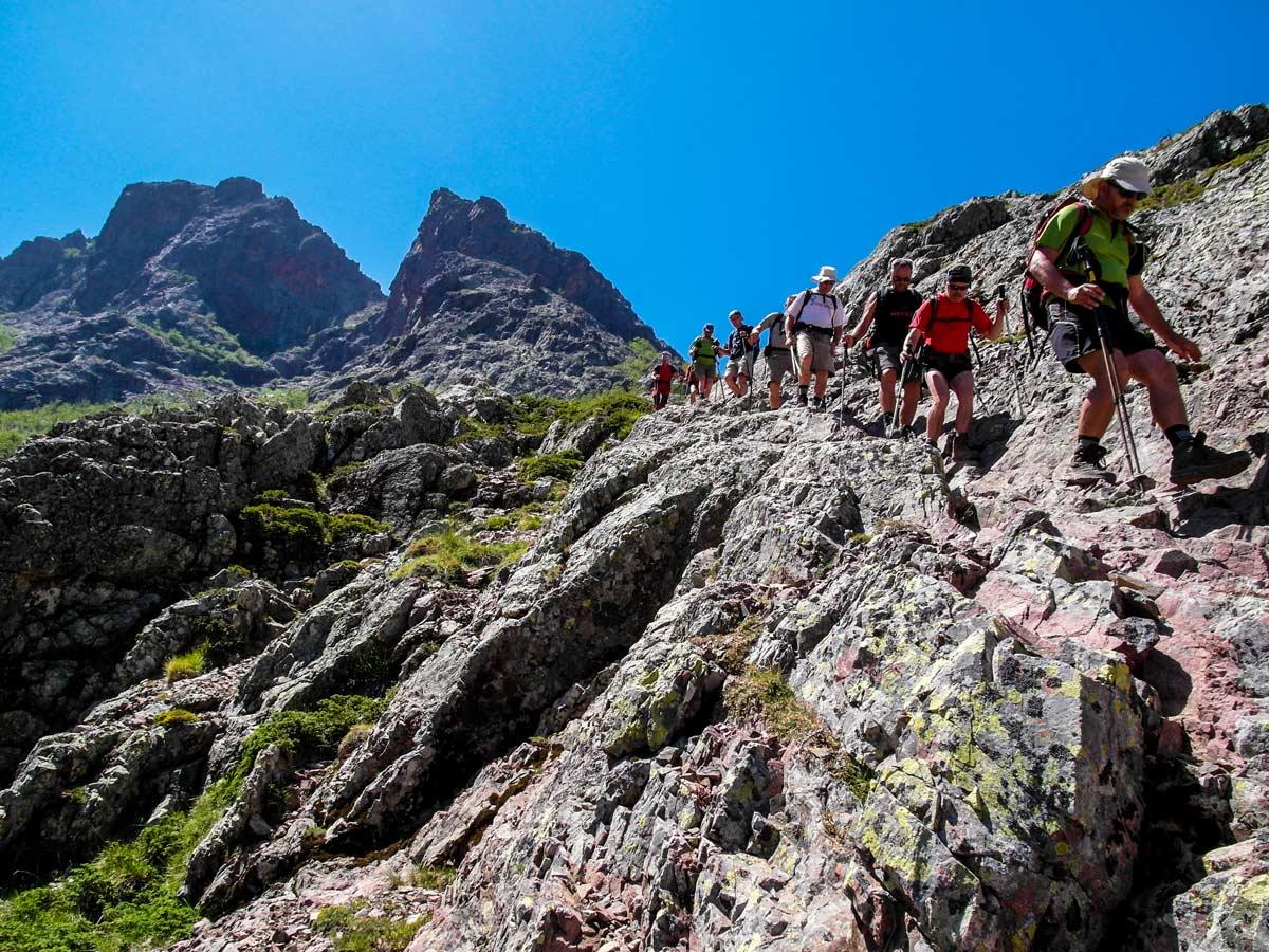 Hikers on the third day of trekking between Bonifatu and Haut Asco on GR20 trek in Corsica