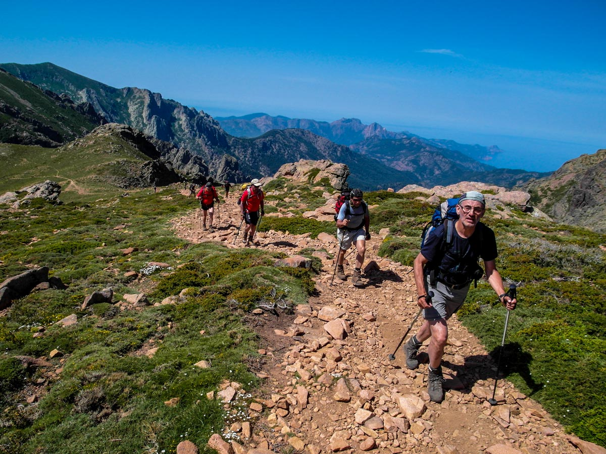 Group of hikers between Vallone and Vergio on GR20 trek in Corsica Island France