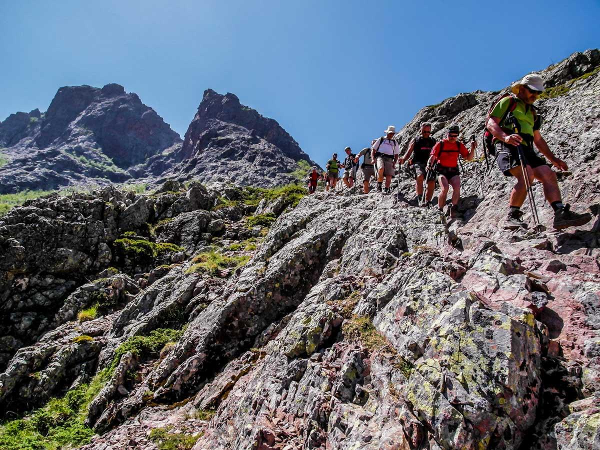 Hikers on the third day of trekking between Bonifatu and Haut Asco on GR20 North trek in Corsica