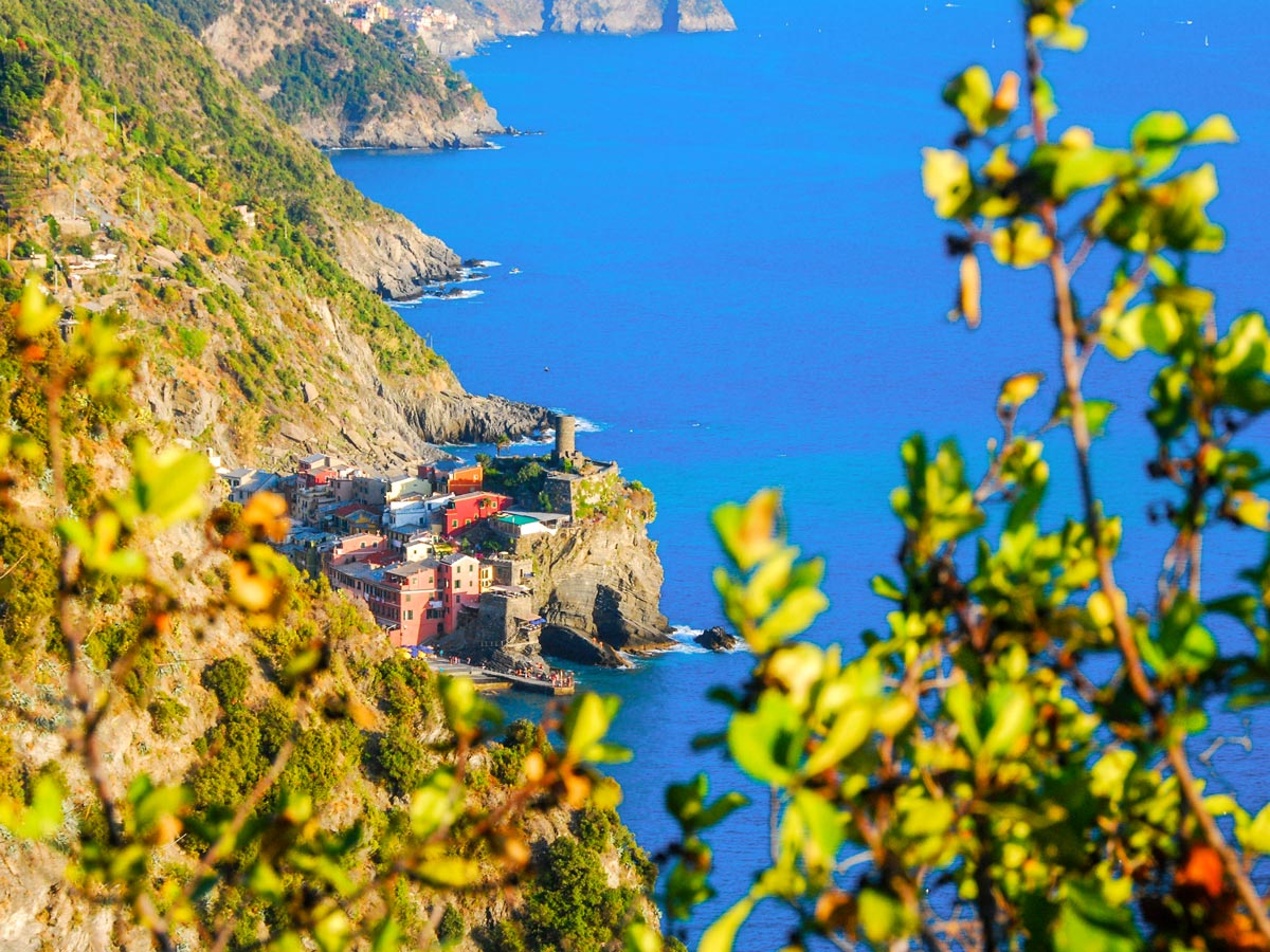 Looking at the blue waters of Mediterranean sea on self guided trek between Portofino and Porto Venere in Cinque Terre