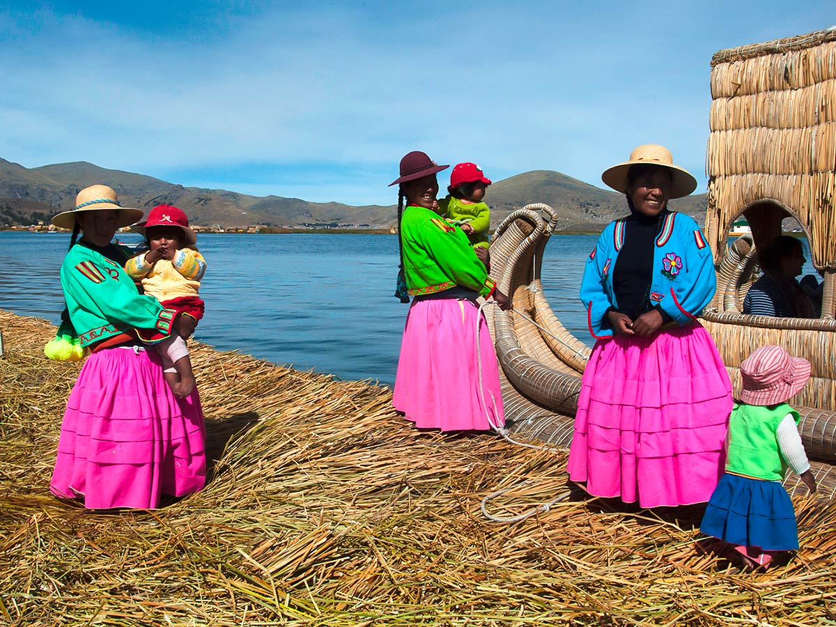 Local peruvian people wearing colorful outfits seen on Peru Active Tour