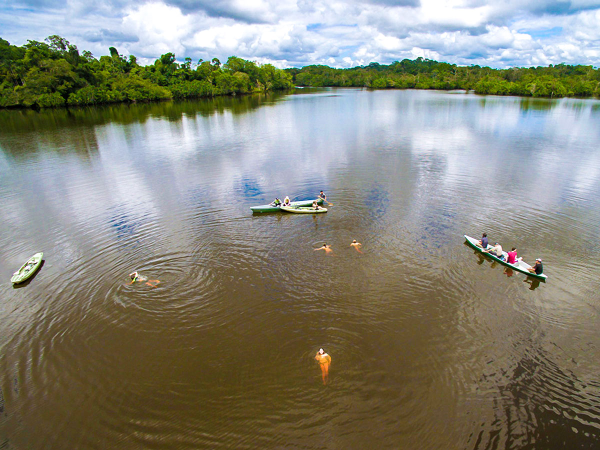 Swimming in the water on Anakonda River Cruise in Ecuador