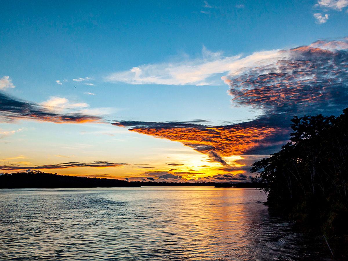 Stunning sunset above Amazon River seen on Anakonda Luxury Cruise Ship
