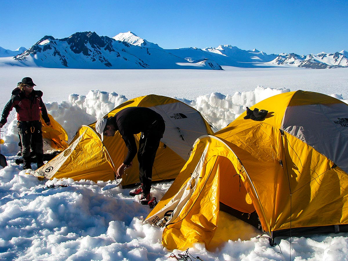 Yellow tents camping on the Patagonias Icefield Trek Trail