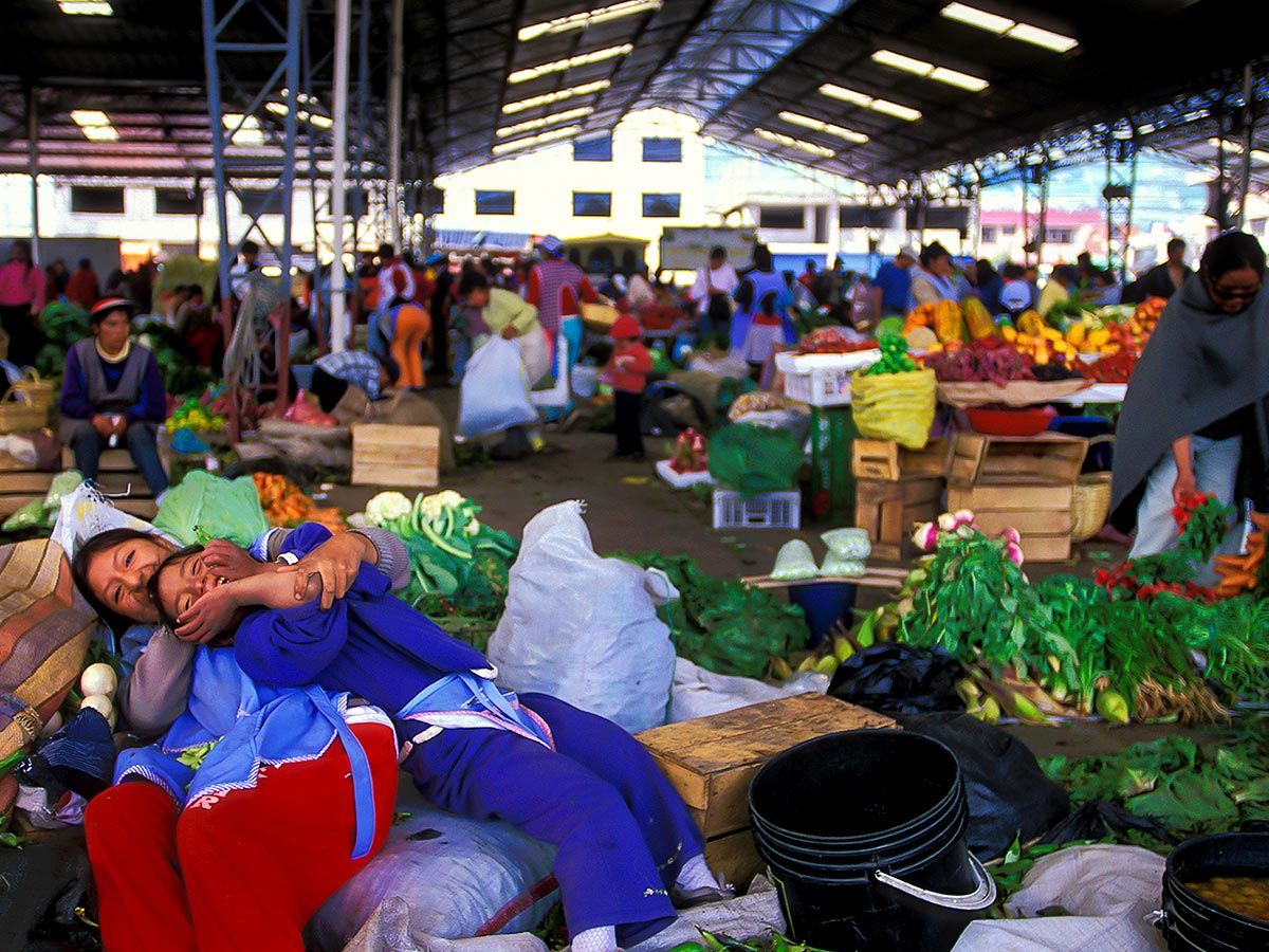 Children playing in Colombian market seen on Peru Ecuador Galapagos tour