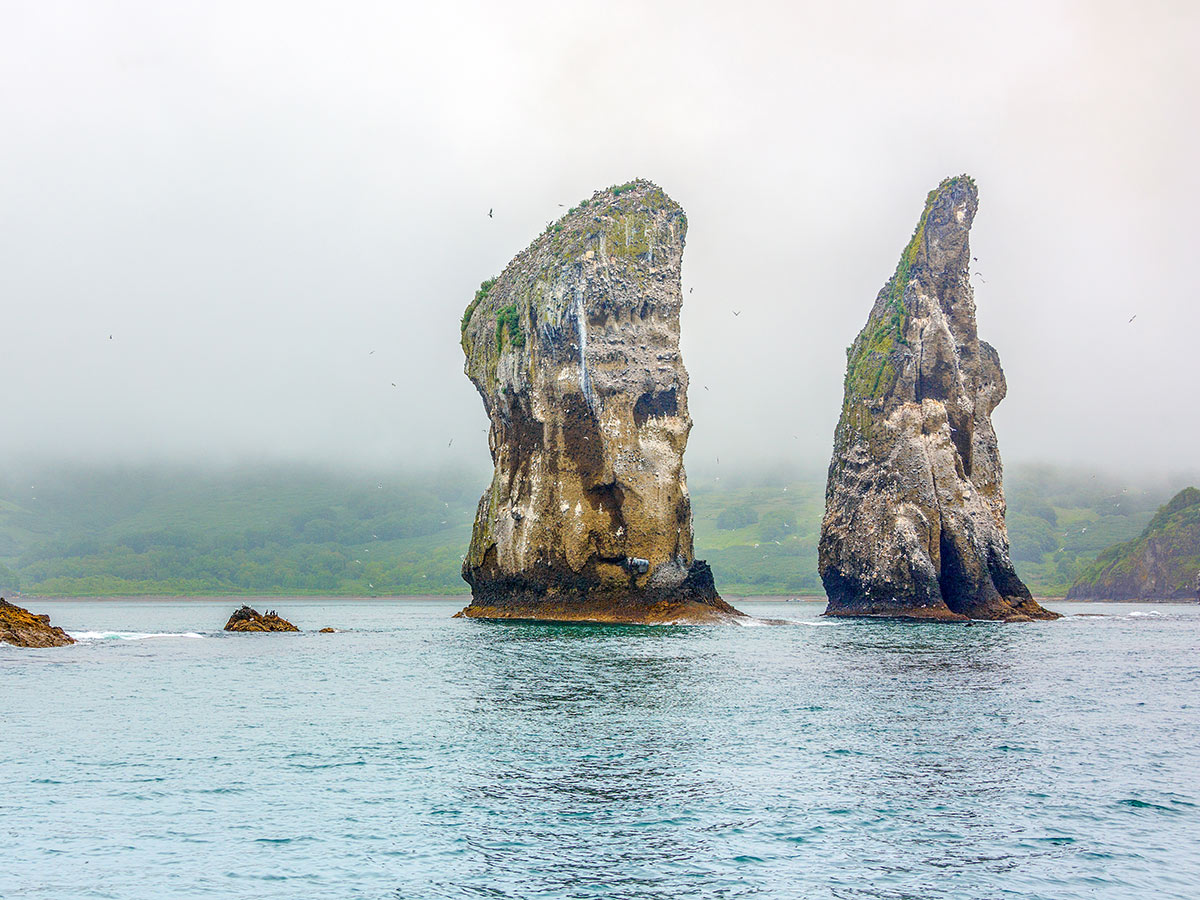 Rock formations along the coast near Kamchatka seen on Classic Kamchatka Trekking Tour