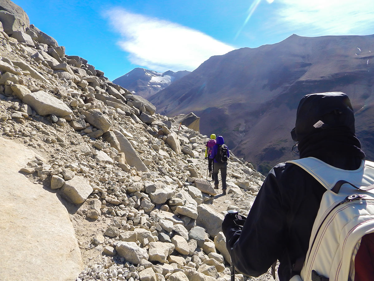 Hiking in Las Torres on day 9 of Full Patagonia Adventure Tour with guide and group
