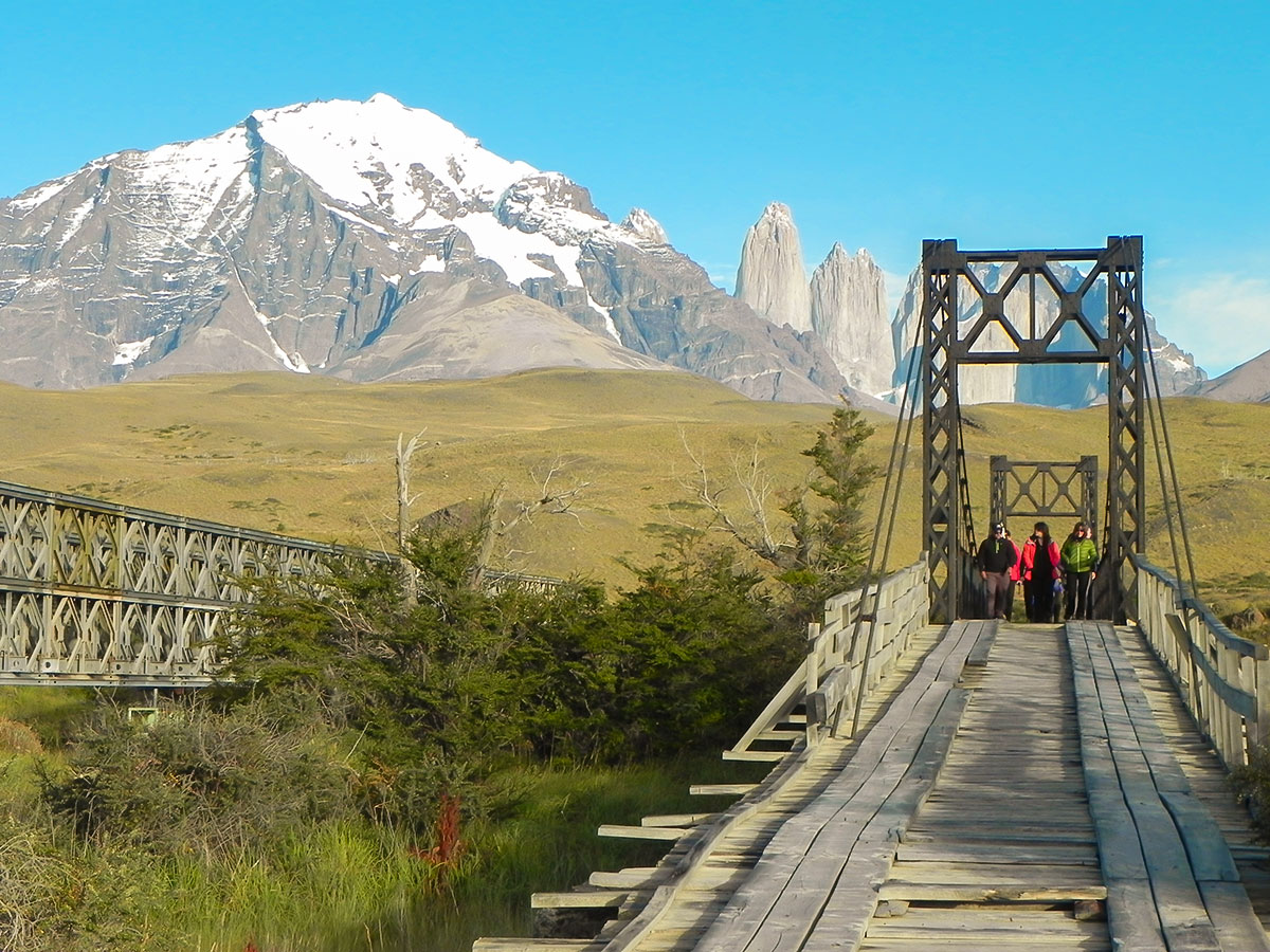 Crossing the bridge over River Paine in Chile on Guided Full Patagonia Adventure Tour in Chile and Argentina
